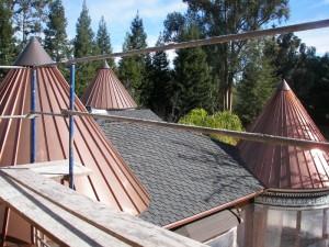 Three copper panel standing seam turrets