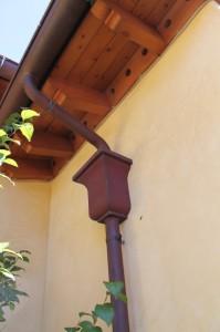Half Round Copper Gutter with cast bronze scroll straps, custom copper leaderheads
