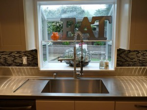 Custom 16 Ga Stainless Steel Countertop with integral drainboard and Vibration Finish